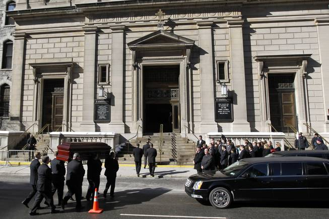 Mourners look on as a casket bearing the remains of Philip Seymour Hoffman is carried into the Church of St. Ingatius Loyola before the actor's funeral Friday, Feb. 7, 2014, in New York.  Hoffman, 46, was found dead Sunday of an apparent heroin overdose.