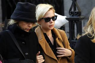 Actress Michelle Williams, right, arrives at the Church of St. Ignatius Loyola for the private funeral of actor Philip Seymour Hoffman Friday, Feb. 7, 2014, in New York. Hoffman, 46, was found dead Sunday of an apparent heroin overdose.