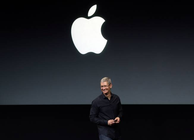 In this Tuesday, Sept. 10, 2013, file photo, Apple CEO Tim Cook speaks on stage before a new product introduction in Cupertino, Calif. Apple has reportedly repurchased $14 billion of its stock in the two weeks after its first-quarter financials and second-quarter revenue outlook disappointed investors. Its shares climbed in premarket trading Friday, Feb. 7, 2014.