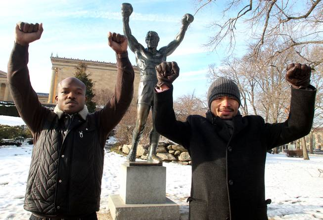 "Feb. 7, 2014, Philadelphia, Pa.   ---  "" JUST LIKE ROCKY"" --- Undefeated WBO World Welterweight champion Timothy Bradley, left, and Manny Pacquiao make a visit to the famous ""Rocky"" statue at the Philadelphia Museum of Art on the final stop on their media tour. The boxers are promoting their upcoming rematch Saturday, April 12 at the MGM Grand Garden Arena in Las Vegas. Chris Farina - Top Rank"