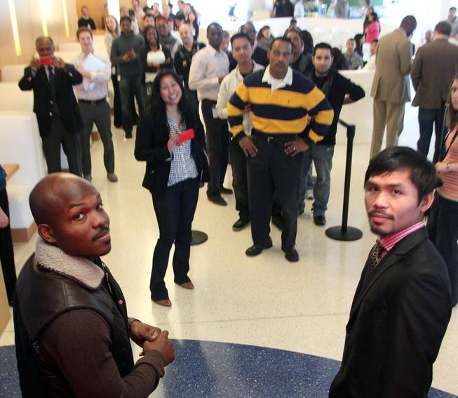 Feb. 7, 2014, Philadelphia, Pa.   ---  (L-R) Undefeated WBO World Welterweight  champion Timothy Bradley and Manny Pacquiao make a special meet 'n greet appearance at Comcast global headquarters in downtown Philadelphia,Pa. on the final stop of their media tour. The boxers are in town to promote their upcoming rematch on Saturday, April 12 at the MGM Grand Garden Arena in Las Vegas. Chris Farina - Top Rank