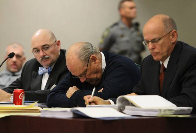 Former Tampa Police Capt. Curtis Reeves Jr., center, sits beside his defense attorneys Richard Escobar, right, and Dino Michaels as they listen to his taped interview by detectives during his bond reduction hearing before Circuit Judge Pat Siracusa at the Robert D. Sumner Judicial Center in Dade City Friday, Feb. 7, 2014.