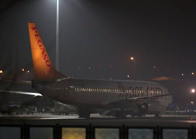 A Pegasus passenger plane at the Sabiha Gokcen Airport in Istanbul, Turkey, Friday, Feb. 7, 2014, after a Ukrainian passenger on an Istanbul-bound flight claimed there was a bomb on board and tried to hijack the plane to Sochi, Russia, where the winter Olympics are kicking off, an official said.