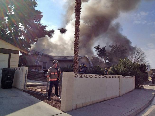 Flames erupted shortly after noon at this home in the 4700 block of El Escorial Drive near Mountain Vista Street and East Flamingo Road, Friday, Feb. 7, 2014.
