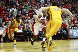 UNLV forward Roscoe Smith makes his move towards the basket against Wyoming during their game Saturday, Feb. 8, 2014 at the Thomas & Mack Center.