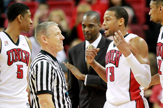 Official Chris Rastatter reacts as UNLV guard Bryce Dejean Jones tries to explain what happened when he was whistled for a technical foul against Wyoming during their game Saturday, Feb. 8, 2014 at the Thomas & Mack Center. UNLV won 48-46.