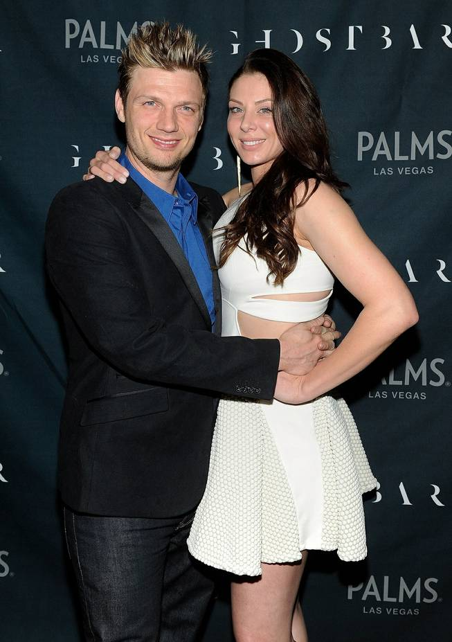 Nick Carter and Lauren Kitt arrive at their joint bachelor and bachelorette parties at Ghostbar on Saturday, Feb. 8, 2014, in the Palms.