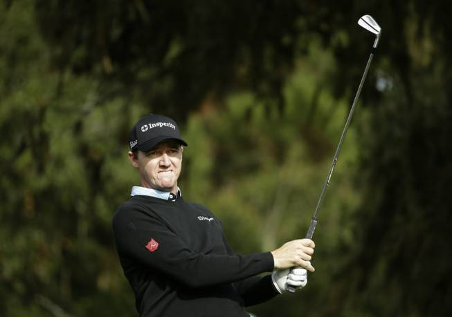 Jimmy Walker follows his shot off the third tee Saturday, Feb. 8, 2014, during the third round of the AT&T Pebble Beach Pro-Am golf tournament on the Monterey Peninsula Country Club Shore Course in Pebble Beach, Calif.