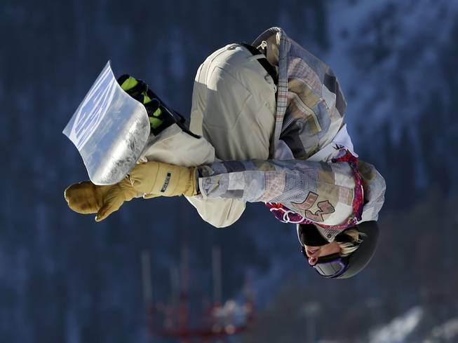 United States' Sage Kotsenburg takes a jump during the men's snowboard slopestyle semifinal at the Rosa Khutor Extreme Park, at the 2014 Winter Olympics, Saturday, Feb. 8, 2014, in Krasnaya Polyana, Russia.