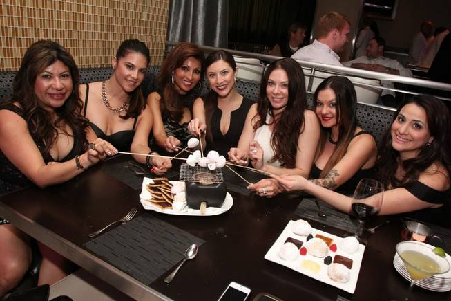 Lauren Kitt, third from right in white, celebrates her bachelorette party at N9NE Steakhouse on Saturday, Feb. 8, 2014, in the Palms.