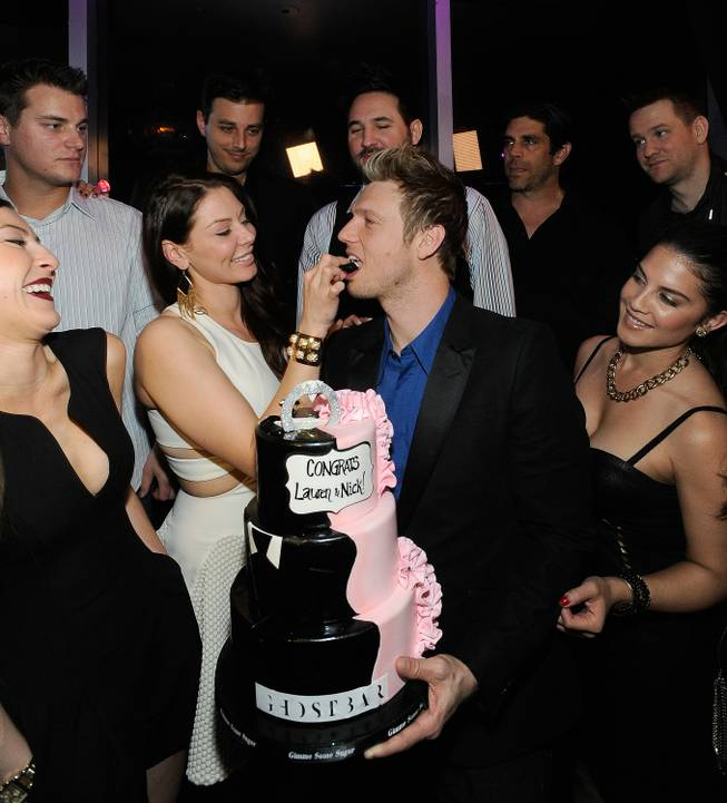 Singer Nick Carter of The Backstreet Boys and his fiancee Lauren Kitt celebrate their joint bachelor and bachelorette parties at Ghostbar on Saturday, Feb. 8, 2014, in the Palms.