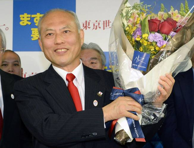 Former Health Minister Yoichi Masuzoe celebrates his gubernatorial election victory at his election office in Tokyo on Sunday, Feb. 9, 2014. Masuzoe, backed by Japan's ruling party, won Tokyo's gubernatorial election, defeating two candidates who had promised to end nuclear power.