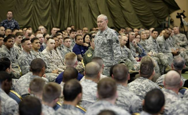 "In this April 25, 2013, file photo, Joint Chiefs Chairman Gen. Martin Dempsey speaks to soldiers of the U.S. Armed Forces in Japan at Yokota Air Base on the outskirts of Tokyo. An Associated Press investigation into the military's handling of sexual assaults in Japan has found a pattern of random and inconsistent judgments in which most offenders are not incarcerated. Instead, commanders have ordered ""nonjudicial punishments"" that ranged from docked pay to a letter of reprimand."