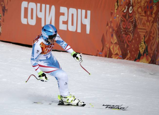 Austria's Matthias Mayer finishes to win the gold in the men's downhill at the Sochi 2014 Winter Olympics on Sunday, Feb. 9, 2014, in Krasnaya Polyana, Russia.