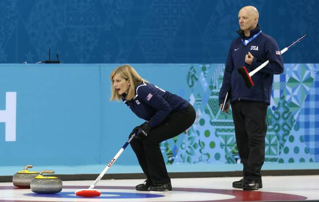 Erika Brown, skip of Team USA, shouts instructions as coach Derek Brown (no relation) looks on during women's training at the the 2014 Winter Olympics on Saturday, Feb. 8, 2014, in Sochi, Russia.