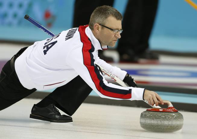 Craig Brown, an alternate on Team USA, delivers the stone during a men's curling training session the 2014 Winter Olympics on Sunday, Feb. 9, 2014, in Sochi, Russia.