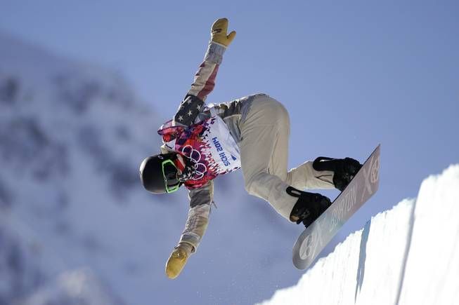 Shaun White of the United States jumps during a training session for the men's snowboard halfpipe at the 2014 Winter Olympics on Saturday, Feb. 8, 2014, in Krasnaya Polyana, Russia.