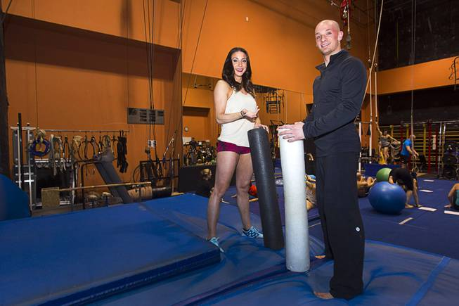 "Colby Lemmo and Josh Fried in a training room before a performance of ""Le Reve — The Dream"" on Monday, Feb. 10, 2014, at Wynn Las Vegas."