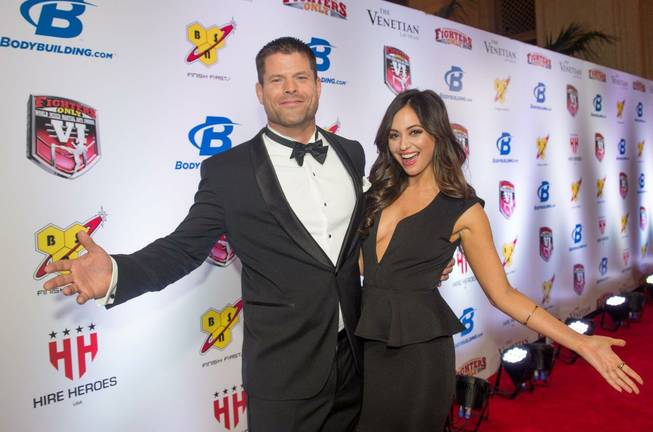 Hosts Brian Stann and Nicole Dabeau arrive at the 2014 ...