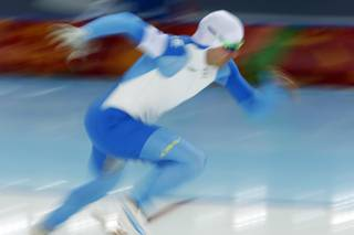 Mika Poutala of Finland takes the start in the second heat of the men's 500-meter speedskating race at the Adler Arena Skating Center during the 2014 Winter Olympics, Monday, Feb. 10, 2014, in Sochi, Russia.