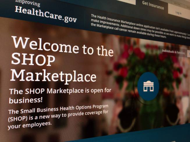 This Nov. 27, 2013, file photo shows part of the HealthCare.gov website page featuring information about the SHOP Marketplace. Trying to limit election-year damage on health care, the Obama administration Monday, Feb. 10, 2014, granted business groups another delay in a much-criticized requirement that larger firms cover their workers or face fines.