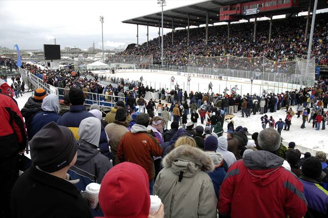 Fans witness the first-ever American League Hockey outdoor game at the New York State Fairgrounds in Syracuse, N.Y., Saturday, Feb. 20, 2010. The Syracuse Crunch hosted the Binghamton Senators in an AHL hockey game.
