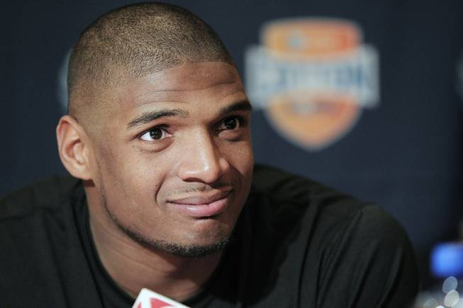 In this Jan. 1, 2014, file photo, Missouri senior defensive lineman Michael Sam speaks to the media during an NCAA college football news conference in Irving, Texas. Sam says he is gay, and he could become the first openly homosexual player in the NFL.