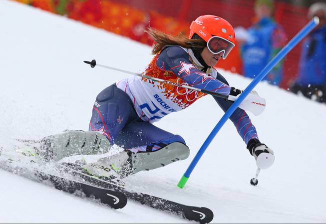 United States' Julia Mancuso passes a gate in the slalom portion of the women's supercombined to win the bronze medal in the Sochi 2014 Winter Olympics, Monday, Feb. 10, 2014, in Krasnaya Polyana, Russia.