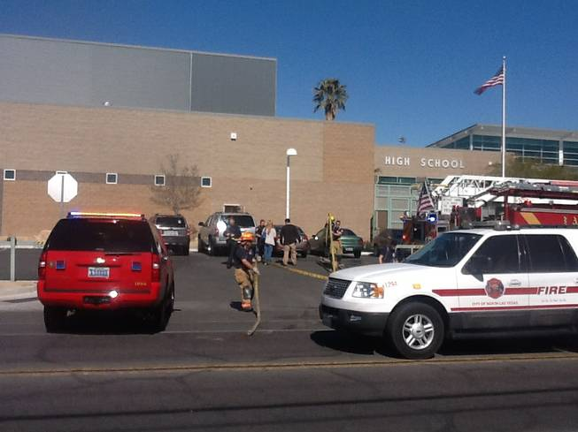 Firefighters respond to a fire at Rancho High School on Monday, Feb. 10, 2014. A stage light ignited the drapery in the theater area of the school, officials said. No injuries were reported.