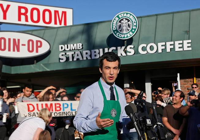 "Canadian comedian Nathan Fielder of the Comedy Central show ""Nathan For You"" comes forward as the brainchild of ""Dumb Starbucks,"" a parody store that resembles a Starbucks with a green awning and mermaid logo, but with the word ""Dumb"" attached above the Starbucks sign."