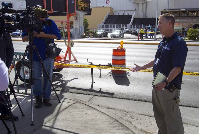Metro Police Sgt. Richard Strader talks to reporters after an auto pedestrian accident at Flamingo Road and Linq Lane (between Koval Lane and the Las Vegas Strip) Tuesday Feb. 11, 2014.