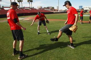 From left, UNLV baseball players Erick Fedde, Eric van Meetren and John Richy juggle a baseball with their feet and gloves during a media availability day Tuesday, Feb 11, 2014.