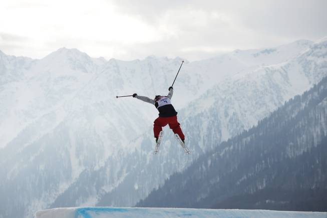 Devin Logan of the United States takes a jump during the women's freestyle skiing slopestyle qualifying at the Rosa Khutor Extreme Park, at the 2014 Winter Olympics, Tuesday, Feb. 11, 2014, in Krasnaya Polyana, Russia.