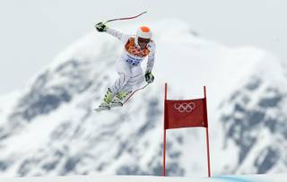 United States' Bode Miller  makes a jump during Men's super combined downhill training at the Sochi 2014 Winter Olympics, Tuesday, Feb. 11, 2014, in Krasnaya Polyana, Russia.