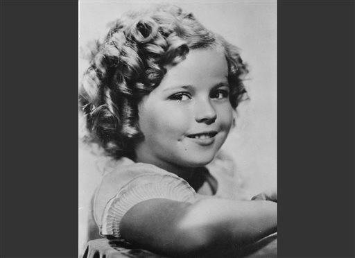 In this November 1936 file photo, 8-year-old U.S. American child movie star Shirley Temple is portrayed in Hollywood, Calif. Shirley Temple, the curly-haired child star who put smiles on the faces of Depression-era moviegoers, has died. She was 85. Publicist Cheryl Kagan says Temple, known in private life as Shirley Temple Black, died Monday night, Feb. 10, 2014, surrounded by family at her home near San Francisco.