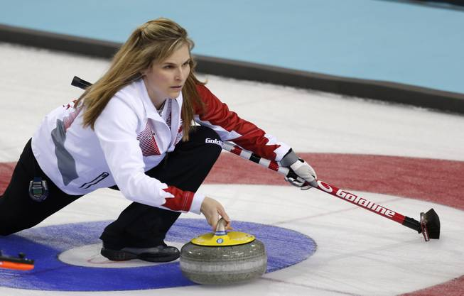 Canada's skip Jennifer Jones delivers the rock to her during women's curling competition against Sweden at the 2014 Winter Olympics, Tuesday, Feb. 11, 2014, in Sochi, Russia.