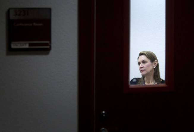 Attorney Elizabeth Quillin is shown through the window of a court conference room as she meets with a client during DUI Court at the Clark County Regional Justice Center Wednesday, Feb. 12, 2014. STEVE MARCUS
