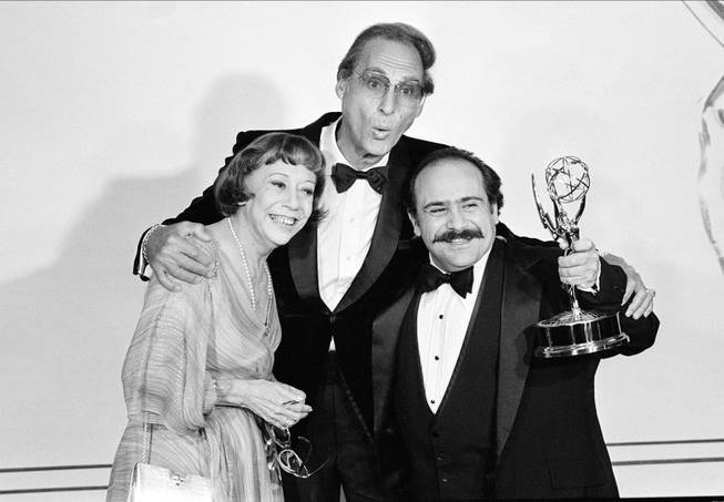 "Sid Caesar, center, and Imogene Coca, left, congratulate actor Danny DeVito with his Emmy award at the 33rd annual Primetime Emmy Awards in Pasadena, Ca., Sunday, Sept. 13, 1981.  DeVito won for supporting performance by an actor in the comedy-variety series ""Taxi."""