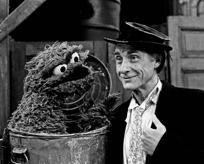 "Guest star Sid Caesar portrays his classic ""professor"" in appearance set for Sesame Street's 15th anniversary season, which begins on the nation's 302 PBS station on Nov. 19, 1985. Oscar the Crouch teaches the professor between ""loud"" and ""quiet"" in a segment that will be broadcast."