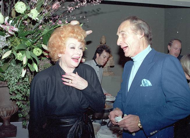 Entertainers Lucille Ball and Sid Caesar share a laugh at a party inaugurating the Fourth Annual Television Festival of the Museum of Broadcasting in Los Angeles, Calif., on Tuesday, March 3, 1987.