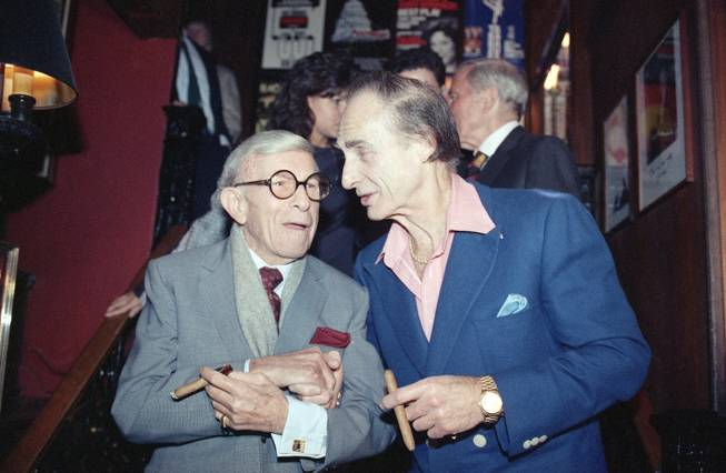 "Sid Caesar, right, poses with George Burns during a party at Sardi?s in New York Wednesday, Nov. 2, 1989, celebrating the opening of Caesar's Broadway play ""Sid Caesar & Company: Does Anybody Know What I'm Talking About."""