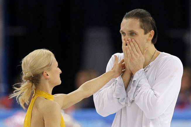 Tatiana Volosozhar and Maxim Trankov of Russia react after they competed in the pairs free skate figure skating competition at the Iceberg Skating Palace during the 2014 Winter Olympics, Wednesday, Feb. 12, 2014, in Sochi, Russia.