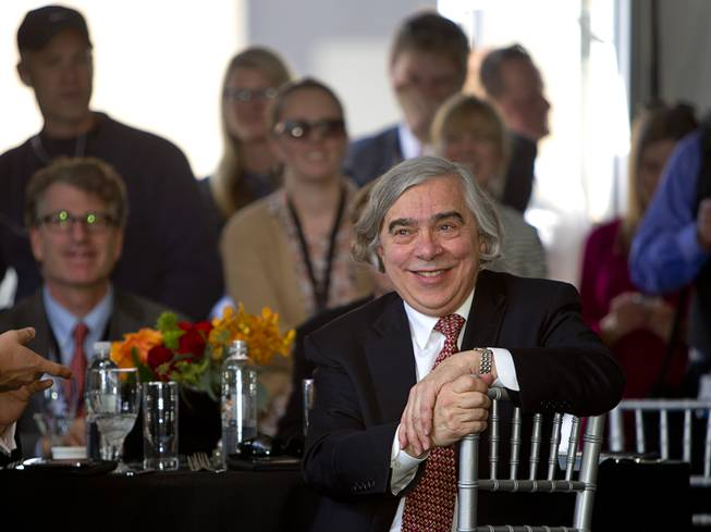 United States Secretary of Energy Ernest Moniz listens to speakers during the grand opening of the Ivanpah Solar Electric Generating System in the Mojave Desert in California near Primm, Nev. Feb. 13, 2014. The project, a partnership of NRG, BrightSource, Google and Bechtel, is the world's largest solar thermal facility and uses 347,000 sun-facing mirrors to produce 392 megawatts of electricity, enough energy to power more than 140,000 homes.