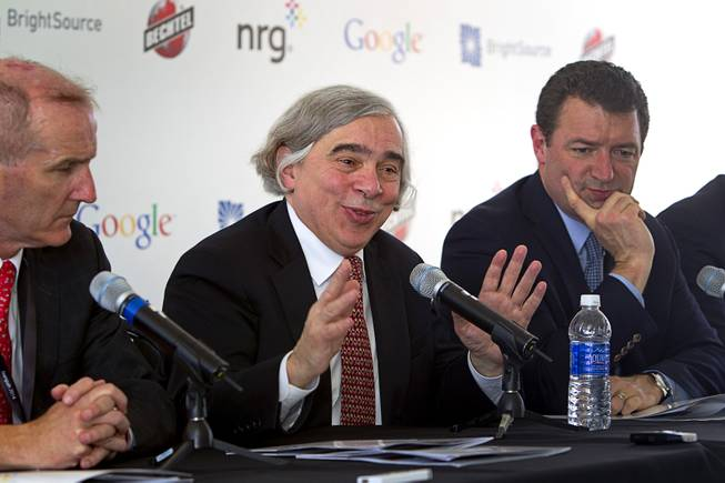 United States Secretary of Energy Ernest Moniz, center, responds to a reporter's question during the grand opening of the Ivanpah Solar Electric Generating System in the Mojave Desert in California near Primm, Nev. Feb. 13, 2014. The project, a partnership of NRG, BrightSource, Google and Bechtel, is the world's largest solar thermal facility. With Moniz are David Crane, left, president/CEO of NRG, and Toby Seay, president of Bechtel Power.