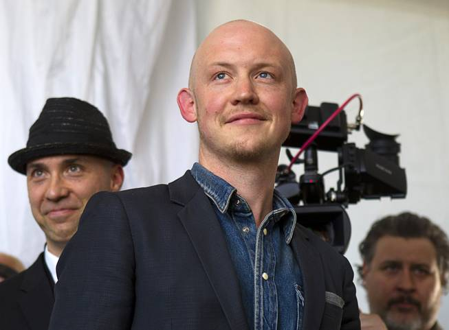 Isaac Slade (C), lead singer of The Fray, attends the grand opening of the Ivanpah Solar Electric Generating System in the Mojave Desert in California near Primm, Nev. Feb. 13, 2014. The project, a partnership of NRG, BrightSource, Google and Bechtel, is the world's largest solar thermal facility. The Fray made a music video at the facility.