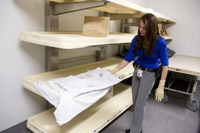 "Clark County Coroner Investigator Felicia Borla handles a two-foot long body bag containing remains of newborn Baby Girl ""Ren"" Doe Thursday, Feb. 13, 2014 at the Clark County Coroner's Office.  Baby Girl ""Ren"" Doe was found stuffed inside a dumpster outside Planet Hollywood back in Oct. of 2013."