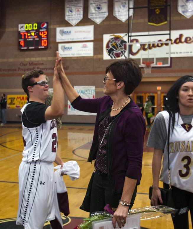 Faith Lutheran senior Clayton Rhodes is congratulated by his mother Shelley for great playing in their basketball game win against Pahrump on Thursday, Feb. 13, 2014.