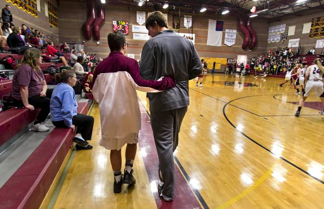 Faith Lutheran seniors Clayton Rhodes and John Molchon walk out onto the court together for their varsity basketball game against Pahrump on Thursday, Feb. 13, 2014.