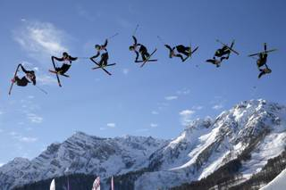 In this image made with a multiple exposure, Finland's Antti Ollila competes in the men's ski slopestyle qualifying at the Rosa Khutor Extreme Park during the 2014 Winter Olympics, Thursday, Feb. 13, 2014, in Krasnaya Polyana, Russia.