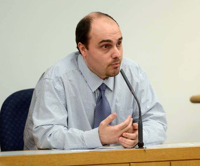 William Cormier, charged with first-degree murder in the death of former Pensacola newspaper reporter Sean Dugas, testifies in his own defense Wednesday, Feb. 12, 2014, in Pensacola, Fla.